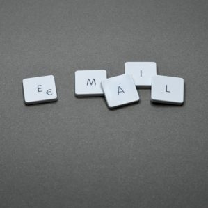 Small tiles or keys spelling out EMAIL on a grey background